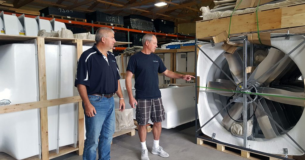 Brett Zickert and Kent Englund in the Agro Air Dynamics warehouse.